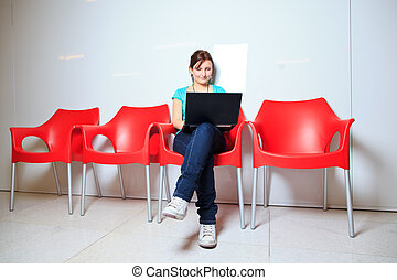 young female student with laptop