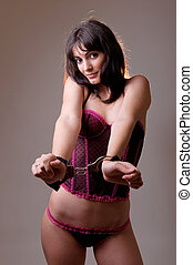 sensual woman wearing a corset and handcuffs - sensual...