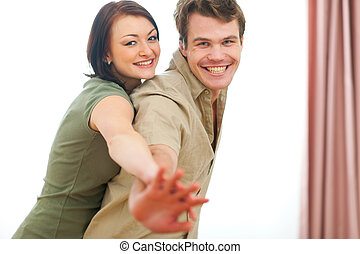 Smiling young couple having fun at home