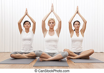 Interracial Group of Three Beautiful Women In Yoga Position...