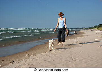 Woman and Dog on a Lake Huron beach - Woman Walking a Small...