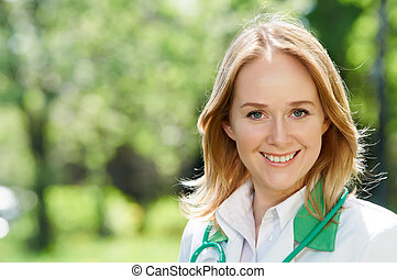 Smiling woman doctor outdoors