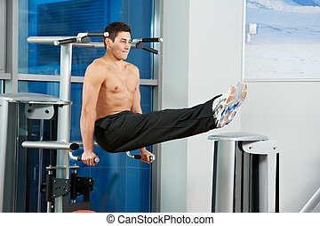 bodybuilding man at abdominal crunch exercises