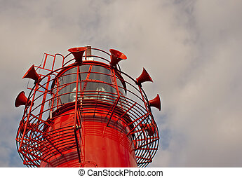 Bright red lighthouse with fog horns
