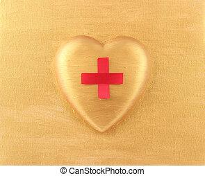 Red Cross on golden heart