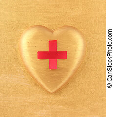Red Cross on golden heart