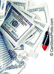 dollar bills with luxury accessories