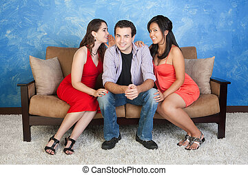 Man with Girlfriends - Two pretty women whisper and flirt...