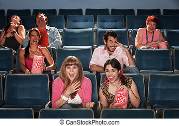 Laughing Audience In Theater - Group of seven people...