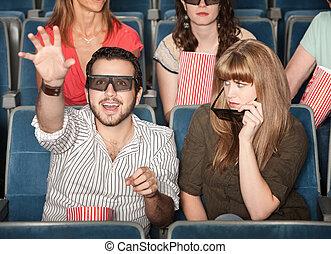 Girlfriend Annoyed With Boyfriend at Movies