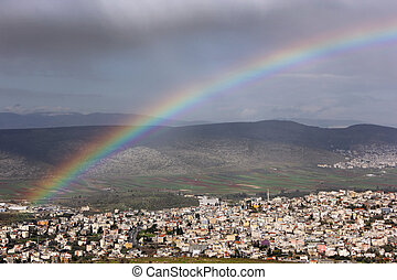 rainbow over the Arab village of Cana in the Galilee region...