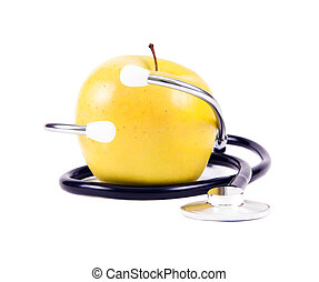Medical stethoscope and yellow apples.