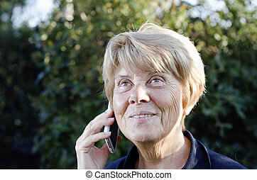 Senior Woman Speaking at the Phone Outdoor