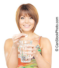 woman with pill and glass of water - picture of woman with...