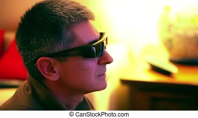 Man With 3D Glasses Watching TV - Closeup of man with 3D...