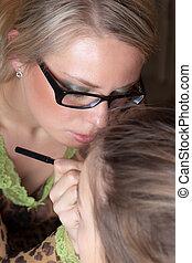 Work of the visagiste - The visagiste imposes a make-up of...