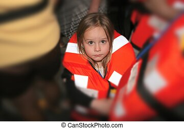 Toddler in Life Preserver - Young girl in a cruise ship...