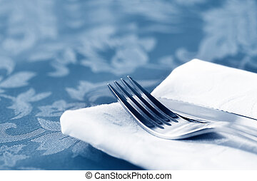 Cutlery on White Linen Over Brocade