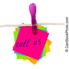 call us written on sticker hanging on rope isolated on white...
