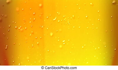 beer bubbles focus - the bubbles floating up in the liquid...