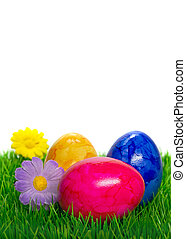 Easter eggs on grass - Painted Easter eggs on grass with...