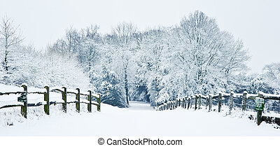 Path through English rurual countryside in Winter with snow