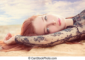 summer portrait - red hair young woman portrait in sand...
