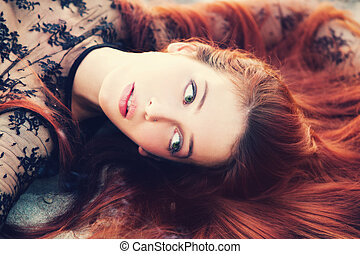 red hair woman portrait outdoors small amount of grain added