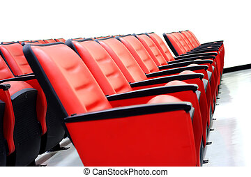 Red theater seats on the white room.