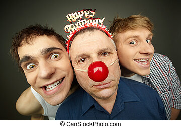 Birthday boy - Two guys having fun playing pranks on a...