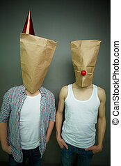 Guys in paper bags - Two guys standing in front of camera in...