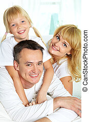 Family together - Family of three spending time together and...
