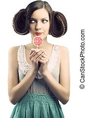 vintage girl with lollipop, she looks at right - young...