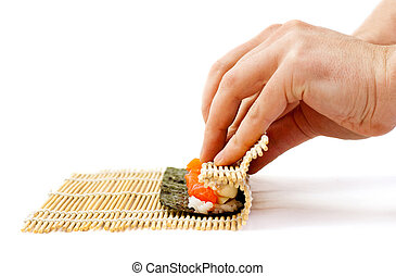 rolling sushi maki - sushi preparation, bamboo mat and sushi...