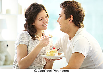 Couple eating cake - Loving couple eating cake together