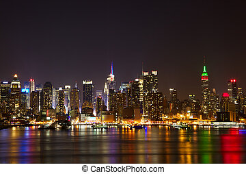 Midtown Manhattan - New York City midtown skyline at night...