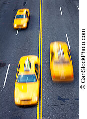 Taxi - Yellow taxi cabs in motion in New York City