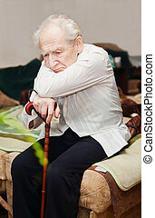 Unhappy Old Man With Cane - sad lonely old man sitting with...