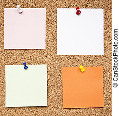 Blank memo notes on cork board