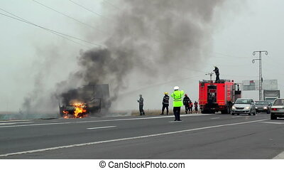 Firefigthers extinguish an truck - firefighters extinguish a...