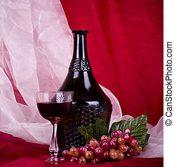 Wine in glass and bottle