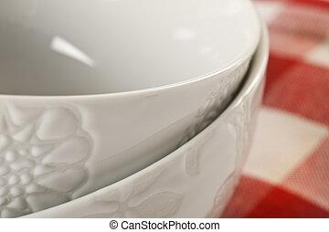 Close up of 2 white bowls - focus o