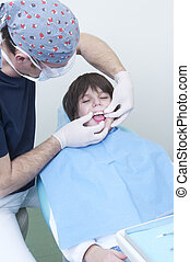boy during a dental visit doctors clinic