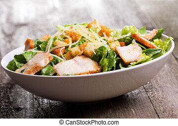 Caesar salad with chicken and greens