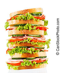 big sandwich with bacon and vegetables on white background