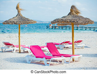 chairs and umbrella on the beach - view of two chairs and...