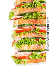 big sandwich with bacon and vegetables