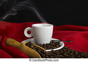 Steaming coffee and coffee beans close up