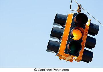 Yellow light traffic signal with copy space - A yellow light...