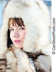 woman wearing fur hat